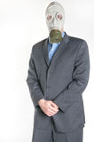 Man in Gas Mask. Men wearing a blue business suit and gas mask simbolizing danger in the environment Stock Photography