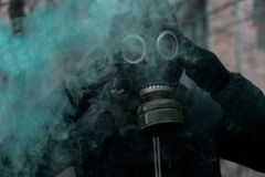Man in gas mask against disaster background. Pollution concept royalty free stock images