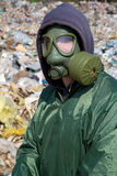 Man in a gas mask against polluted nature Royalty Free Stock Photography