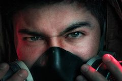 A man in a gas mask on a black background Royalty Free Stock Image