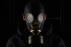 Man with gas mask. Man with gas mask on black background and dim light Royalty Free Stock Photography