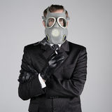 Man in a gas mask with a cigarette Royalty Free Stock Photos