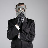 Man in a gas mask with a cigarette Stock Photo