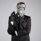 Man in a gas mask with a cigarette Royalty Free Stock Photography