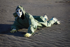 Man in gas-mask on desert ground Royalty Free Stock Photos