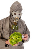 Man with gas mask exploring vegetables Royalty Free Stock Photos