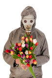 Man with gas mask and flowers Stock Photos