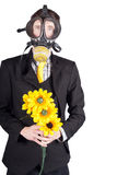Man in gas mask with flowers Stock Photos