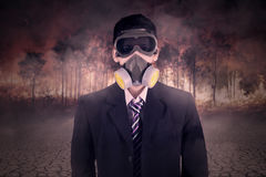 Man with gas mask and forest fire Royalty Free Stock Photo