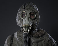 The man in a gas mask. On a gray background Royalty Free Stock Photos
