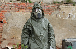 Man with gas mask and green military clothes  explores  area Royalty Free Stock Photography