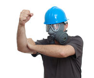 Man in gas mask and hardhat Stock Image