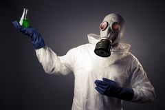 Man with a gas mask holding radioactive liquid Royalty Free Stock Images
