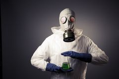 Man with a gas mask holding radioactive liquid Royalty Free Stock Image