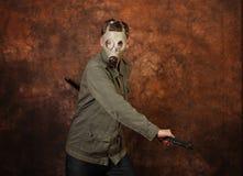 Man with gas mask and  katana sword on brown batik  background. Man with gas mask and  katana sword on brown batik background Stock Photos