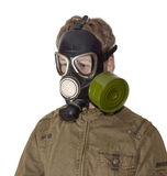 Man in a gas mask on a light background Royalty Free Stock Image