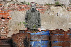 Man with gas mask and  military clothes   after chemical disaster . Stock Photos