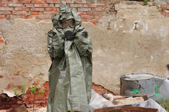 Man with gas mask and military clothes  after chemical disaster Stock Image