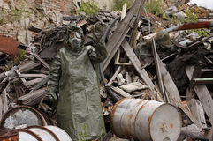 Man with gas mask and military clothes after chemical disaster Stock Photos