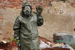 Man with gas mask and military clothes  explores   dead bird Stock Images