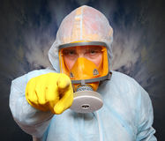 Man in gas mask. Man in protective clothing with respirator. Infection control concept Royalty Free Stock Photography
