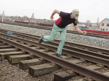 Man in gas mask running the sleepers. Man in gas mask running at the sleepers Stock Photos