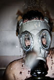 Man in gas mask with water reflection in the eyes Stock Photos