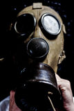 Man with a gas mask Stock Images