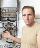 The man and  gas water heater Royalty Free Stock Images