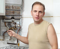 The man and gas water heater Stock Images