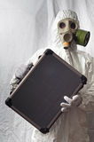 Man in gasmask. Showing case in white tent stock image