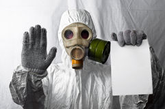 Man in gasmask. Showing stop and copyspace paper stock images