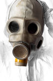 Man in gasmask. Taking off mask in white suit royalty free stock image