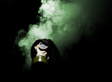 Man in gasmask. With abstract smoke on black background Stock Photo