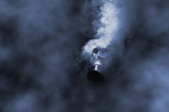 Man in gasmask. With abstract smoke on black background Stock Photography