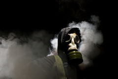 Man in gasmask. With abstract smoke on black background Royalty Free Stock Images