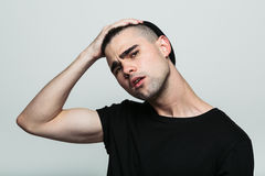 Man gather his brows. Royalty Free Stock Photo