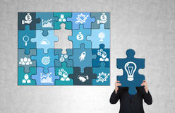 Man gathering a puzzle Royalty Free Stock Photos