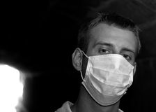 Man with gauze bandage in dark tunnel. (black and white image Stock Photo