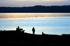 Seahurst Silhouette. A man gazes at the sunset from Seahurst Park in Burien, Washington stock photos