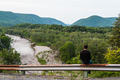 Man gazing out to the hills. And mountains in Cape Breton stock image