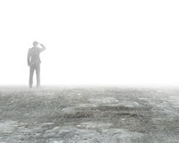 Man gazing and standing in mist on dirty concrete floor. Man gazing and standing in mystery fog on dirty concrete floor Royalty Free Stock Photography
