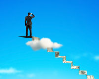 Man gazing on top of money stairs. With blue sky background royalty free stock photography