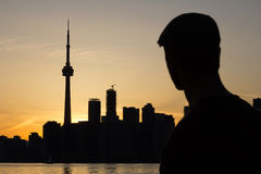 Man gazing towards the city of Toronto Stock Image