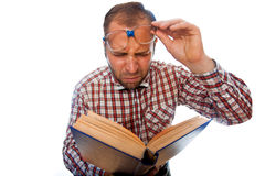 Man geek with poor eyesight try to read book Stock Images