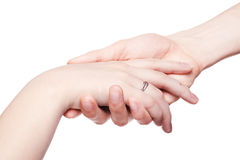 The man gently holds a female hand. With ring. Isolated white royalty free stock photo