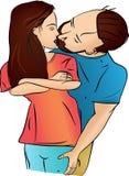 Man gently kissing flirting women.  Stock Images