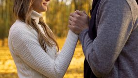 Man gently warming hands of his beloved woman, tenderness and sincere feelings stock image