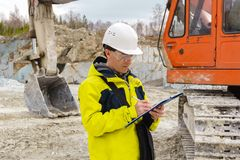 Man geologist or mining engineer at work stock image