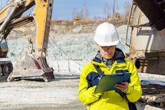 Man geologist or mining engineer at work royalty free stock image